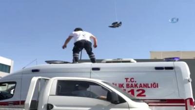 Tellere takılan güvercin 112 Acil Sağlık ekibi tarafından kurtarıldı